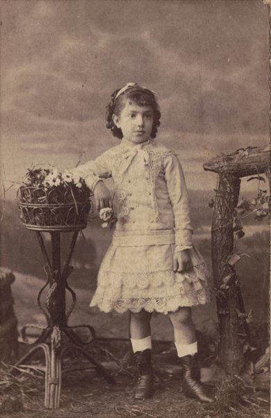 Portrait of a young girl in white dress