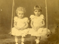 Untitled (studio portrait of two little girls on a swing)