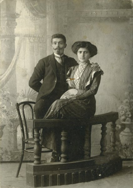 studio portrait of a husband and wife