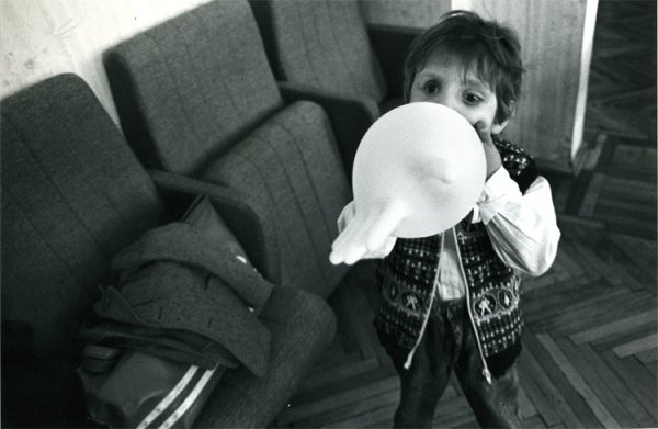 untitled from Earthquake, Armenia series [a survivor child with baloon]