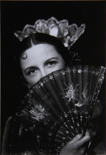 Untitled (portrait of a woman in Spanish flamenco costume covering her face with a fan)