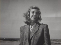 Untitled (young woman in a tweed jacket on a beach)