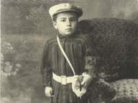 untitled (studio portrait of a small boy with a hat and white belt)