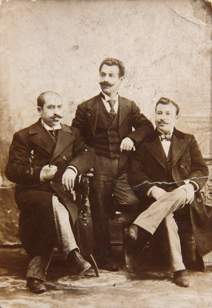 Studio portrait of three gentlemen