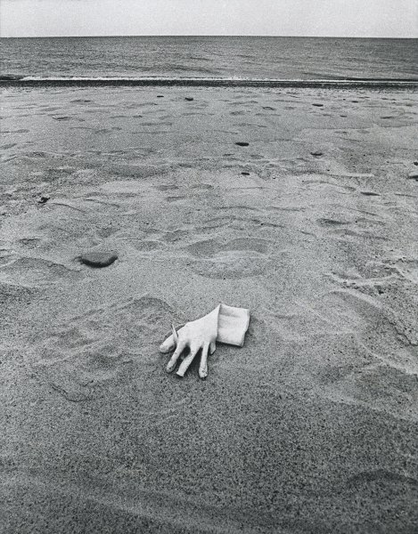 Untitled (glove on the beach)