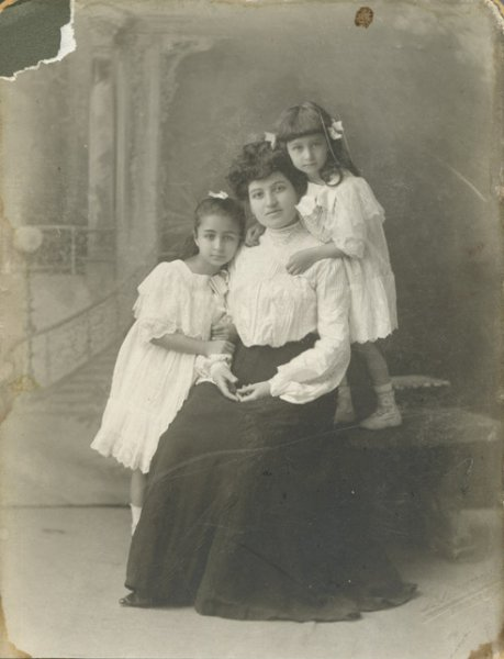 Untitled (studio portrait of a mother with her two young daughters)