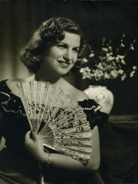 Untitled (studio portrait of a woman with a fan)