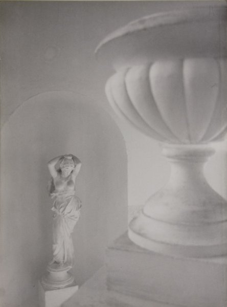 Untitled (sculpture and vase on a staircase)