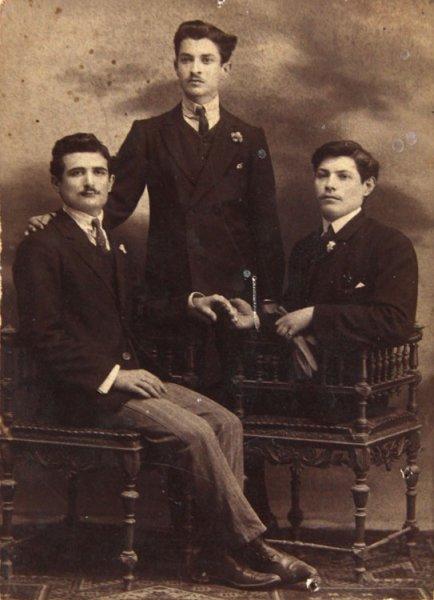 Studio portrait of three male friends