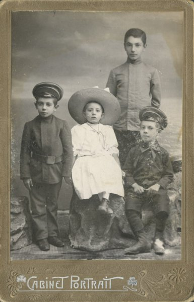 Untitled (studio portrait of three brothers and their sister)