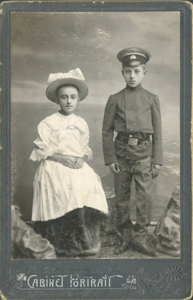 Untitled (studio portrait of a boy in a school uniform and his sister)