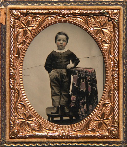 Untitled (Portrait of a boy standing on a chair)