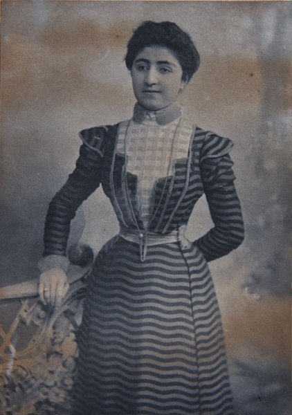 Portrait of a young woman in striped dress