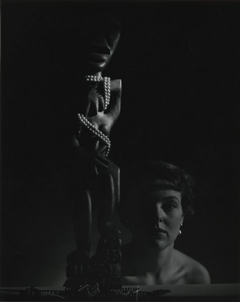 Untitled (model with a Tiki sculpture)